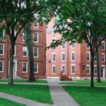 Image of two brick buildings on campus